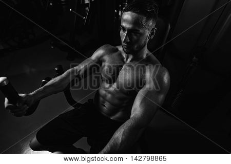 Young Man Doing Heavy Weight Exercise For Chest