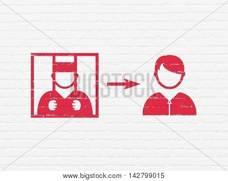 Law concept: Painted red Criminal Freed icon on White Brick wall background