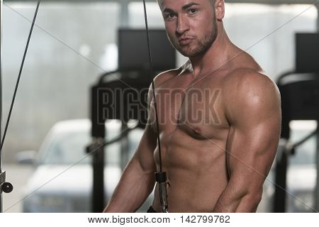 Bodybuilder Doing Heavy Exercise For Triceps With Cable