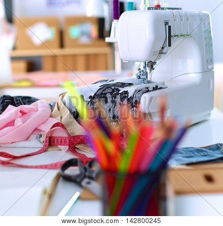 Designer work place with sew manikins, in office.