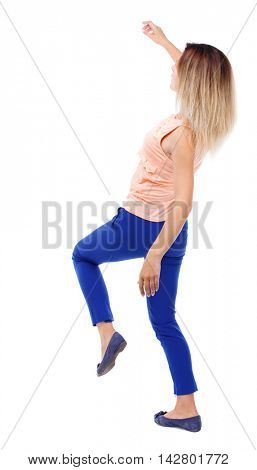 Balancing young woman.  or dodge falling woman. Rear view people collection.  backside view of person.  Isolated over white background. The blonde in a pink shirt leans back.