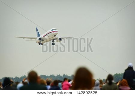 Zhukovsky, Moscow region, Russia - August 24, 2009: The Sukhoi Superjet 100 is a modern fly-by-wire twin-engine regional passenger jet at the International Aviation and Space salon MAKS-2009