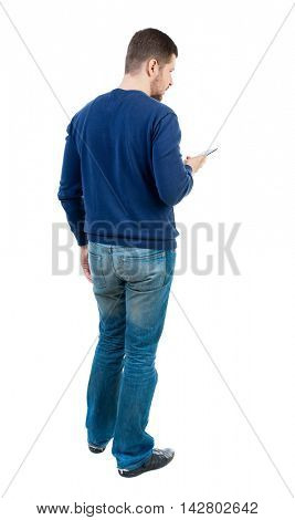 back view of business man uses mobile phone.    rear view people collection. Isolated over white background. backside view of person. bearded man in blue pullover looks to the smartphone.