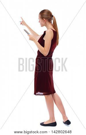 back view of pointing young beautiful  woman and using a mobile phone. girl  watching. Rear view people collection.  backside view of person.  Isolated over white background. Slim blonde in a burgundy