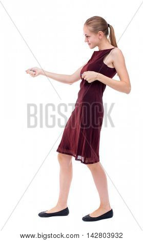 back view of standing girl pulling a rope from the top or cling to something. girl  watching. Rear view people collection.  backside view of person.  Isolated over white background. A girl in a