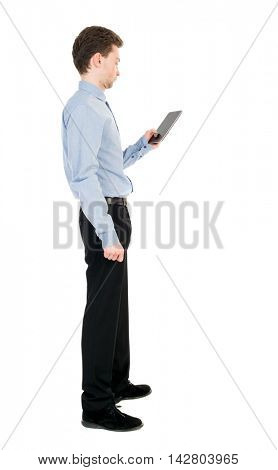 back view of business man uses mobile phone.    rear view people collection. Isolated over white background. backside view of person. The curly-haired businessman in light shirt stands sideways and