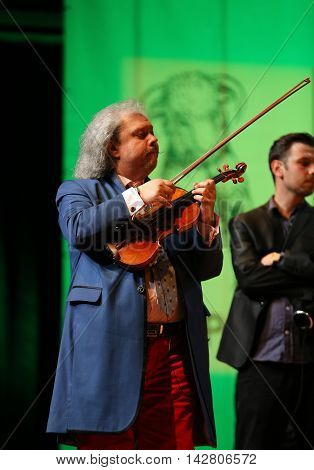 CRACOW POLAND - JUNE 11 2016: Roby Lakatos Romani violinist from Hungary playing live music at Summer Jazz Festival in Cracow Poland