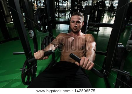 Chest Exercise On Machine In Gym