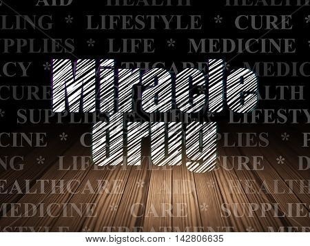 Medicine concept: Glowing text Miracle Drug in grunge dark room with Wooden Floor, black background with  Tag Cloud