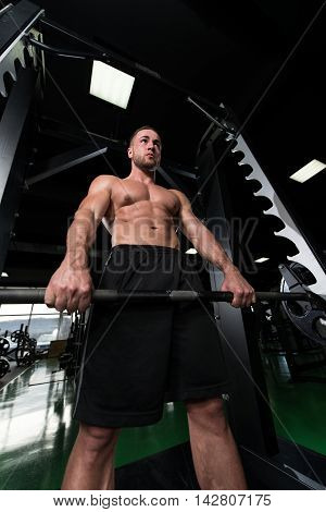 Back Exercise With Barbell In Fitness Center