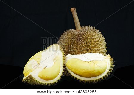 Tropical fruits Durian on black background (dramatic style)