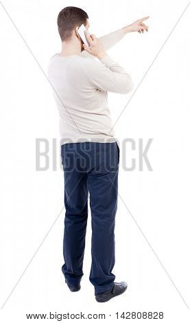 Back view of  pointing young men talking on cell phone. Young guy  gesture. Rear view people collection.  backside view of person.  Isolated over white background. The bearded man in a white sweater