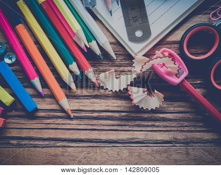 Close up office supplies on vintage style background