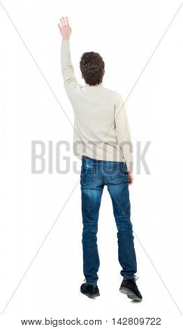 Back view of  man.  Raised his fist up in victory sign.  Rear view people collection.  backside view of person.  Isolated over white background. Curly short-haired guy in a white woolen waving goodbye