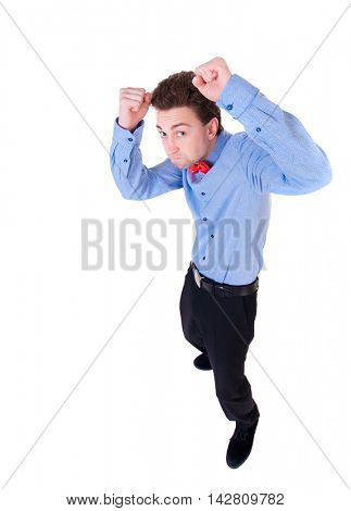 businessman in a tie butterfly in a fighting stance. Isolated over white background. Rear view people collection.  backside view of person. the little man fighting with their fists.