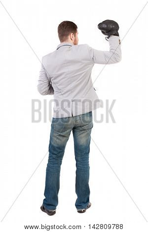 businessman with boxing gloves in fighting stance. Isolated over white background. Rear view people collection.  backside view of person. Man in gray suit and boxing gloves raised his hand in a sign