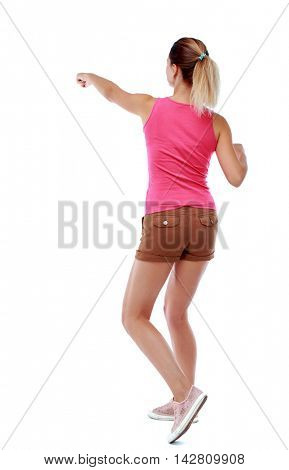 back view of woman funny fights waving his arms and legs. Rear view people collection. backside view of person.  Isolated over white background. Sport blond in brown shorts fighting with their fists.