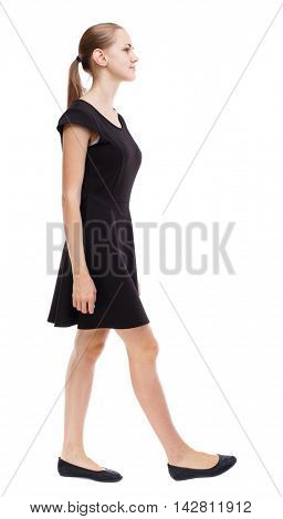 back view of walking  woman. beautiful girl in motion.  backside view of person.  Rear view people collection. Isolated over white background. Blonde in a short black dress goes on the side