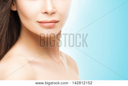 Close-up portrait of young and healthy woman with beautiful skin.