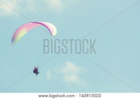 Tandem Paragliding Flight On Sunny Blue Sky