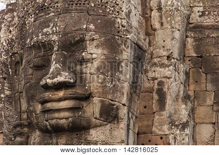 Large Faces On Ancient Stone Temples Cambodia.