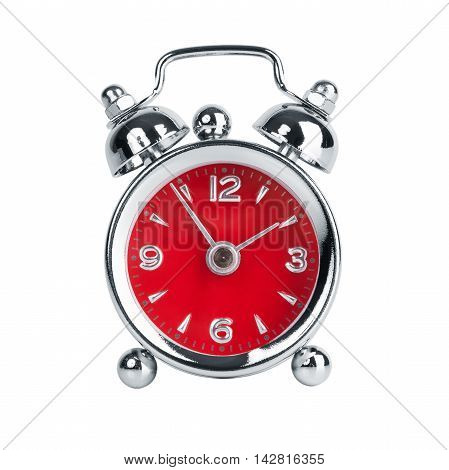 Five to two on a round metal alarm clock