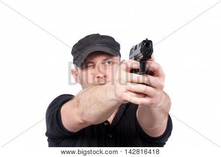 Man pointing gun isolated on white. Focus on the gun