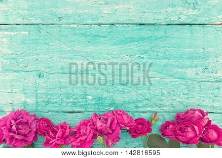 Frame Of Roses On Turquoise Rustic Wooden Background. Spring Flowers. Spring Background. Valentine's