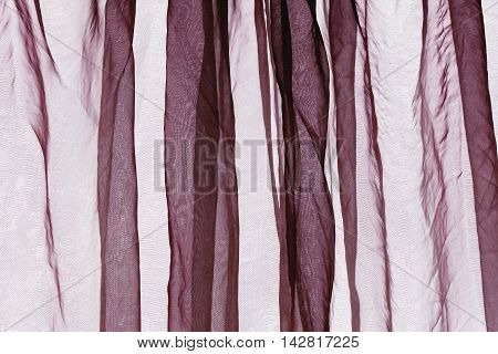 Voile curtain background in colour maroon dark red