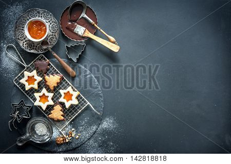 Christmas baking background with cookies, cookie cutters, spices and other ingredients