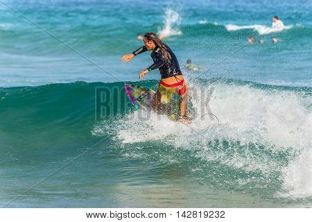 Sydney Australia - November 26 2014: A Australian surfer on the crest of a wave Bondi Beach in the Eastern Suburbs Sydney New South Wales Australia.