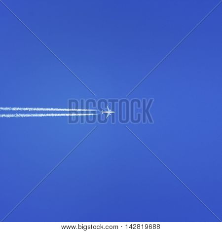 High altitude airplane in blue sky