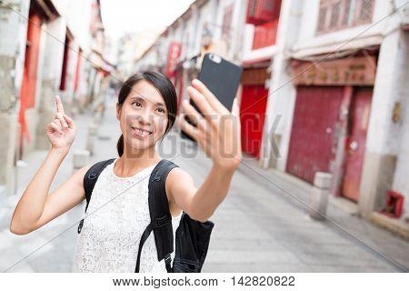 Woman taking selfie by cellphone