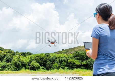 Woman play with drone
