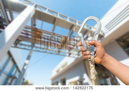 Safety belt lock in Hand.Safety For safe operation on high.
