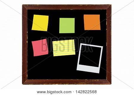 Blank vintage wooden picture frame made of wood in brown with sticky notes, instant film, isolated on white background