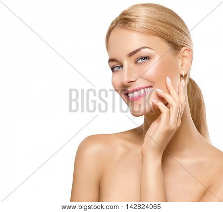 Beauty Woman Portrait. Beautiful Spa Girl Touching her Face and smiling. Perfect Fresh Skin. Pure Beauty Model Female looking at camera. Youth and Skin Care Concept. Isolated on white background
