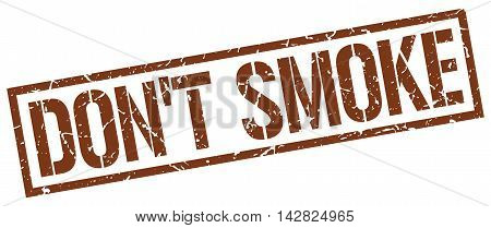 don't smoke stamp. brown grunge square isolated sign