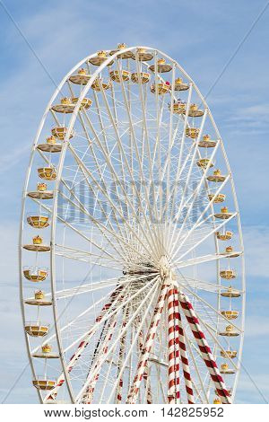 Ferris wheel at an amusement park with blue sky