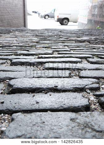 Old cobblestone road, monochrome image, stone texture.