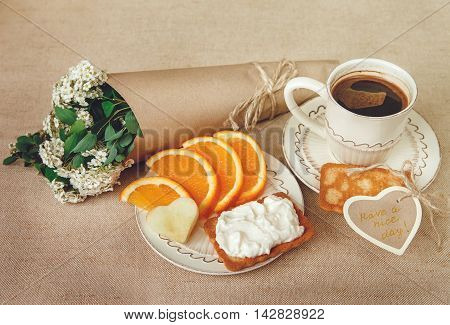 Healthy Organic Breakfast.Cup og Coffee,Cut Orange,Biscuit with Cottage Cheese.Wish Card with Flowers.
