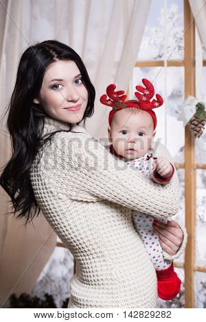 Beautiful Woman Posing With Her Baby