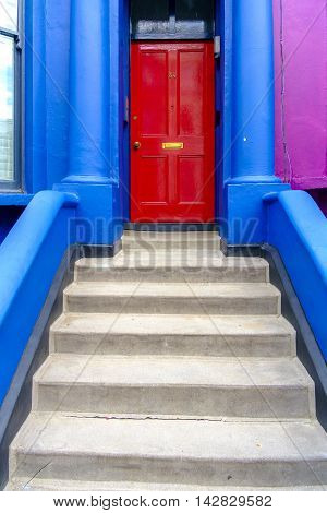 Brightly Colored Front Entrance To A London Home