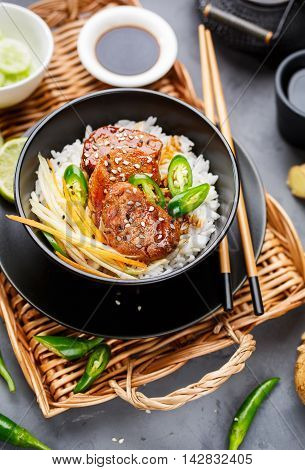Asian food - roast meat with rice and vegetables. Food background