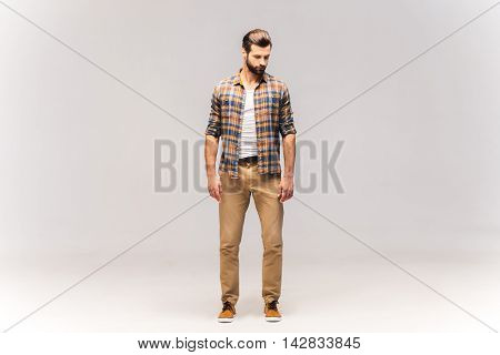 Casually handsome. Full length studio shot of handsome young man in casual wear