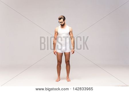 Man in underwear. Full length studio shot of handsome young man in underwear