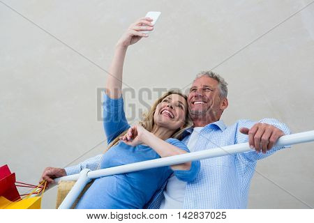 Low angle view of couple taking selfie at home
