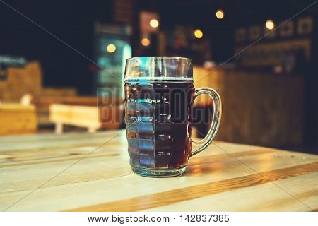 A Chilled Glass Of Fresh Dark Beer On The Wooden Bar Counter In Pub With Free Space For Your Text. B