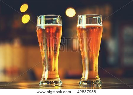 Two Glasses Of Fresh Cold Light Beer On A Wooden Bar Counter In Pub With Free Space For Your Text. B