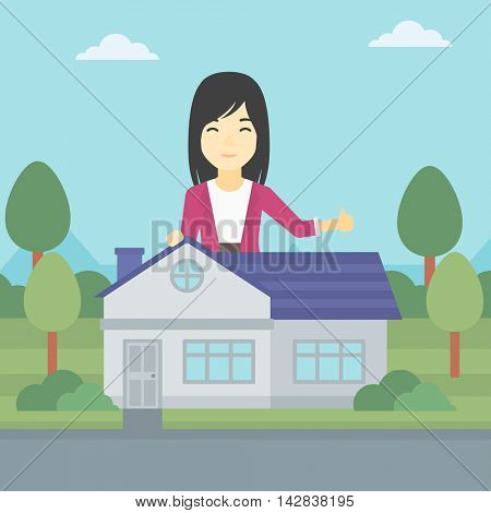 An asian young woman standing behind the house and showing thumb up. Female real estate agent offering the house. Young woman giving thumb up. Vector flat design illustration. Square layout.